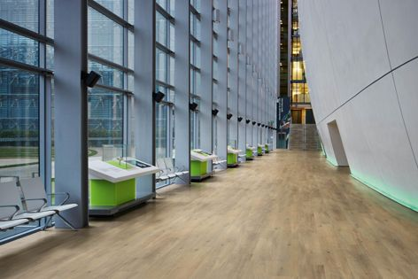 The Korlok floating floor collection is available in 12 wood designs including Canadian Urban Oak.
