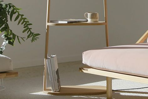 Stack by Nau combines lamp, bookshelf and side table in one refined design.