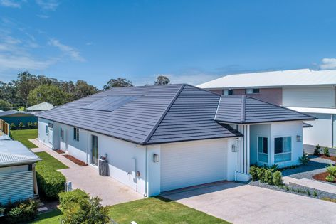 The Inline Solar system combines with Monier's Cambridge Concrete range in 'Soho Night' at this Brisbane house.