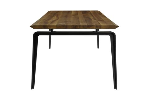 Featuring an angled top that resembles an airplane wing, the Ligne Roset Odessa dining table is clean-cut and minimal.