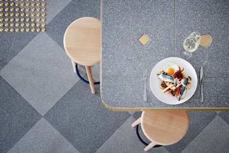 Steel and Platinum terrazzo tiles feature in a chequerboard pattern at Middletown Cafe by Studio Tate. Photography: Peter Clarke.