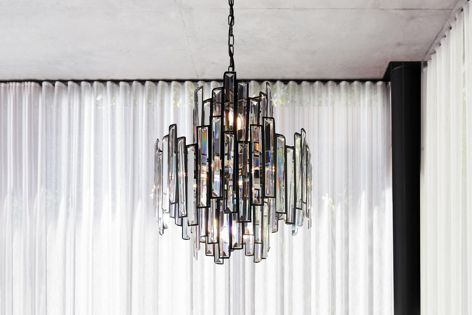 The Empire 12-light chandelier from Beacon Lighting Commercial is crafted from glass.