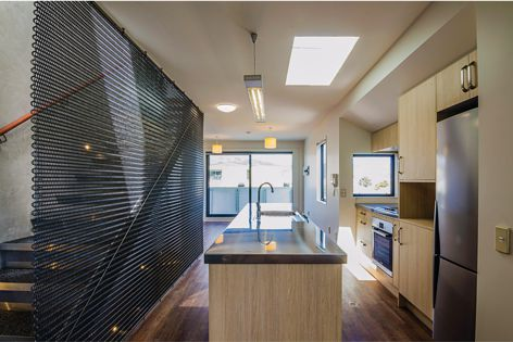 The Obsidian Black Kaynemaile mesh complements the colour tones of this apartment fitout.