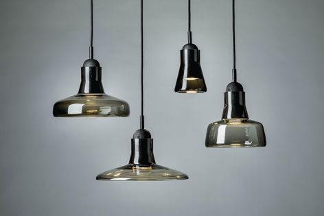The Shadows lighting series features glass shades in four shapes.