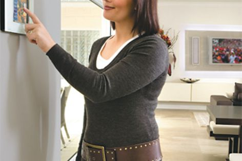 C-Bus PointOne system manages lighting, home entertainment, motorized blinds and climate control.