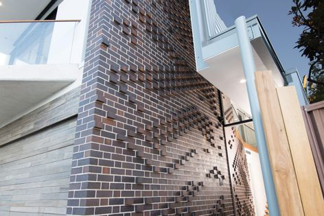 PGH Dry Pressed Mowbray Blue face bricks in a Flemish bond were used to create this pixelated feature wall at a contemporary Sydney home.