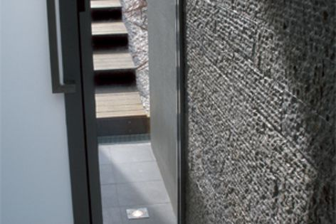 The textured finish of Cascade Stone becomes a dramatic feature wall in this entry.