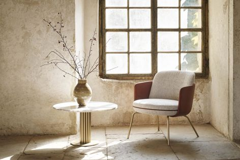 The Miles table pictured with Wittmann's Merwyn chair. Photography: Gregor Titze.