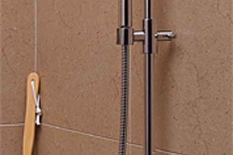 The Academy rail shower from Raymor, featuring an integrated rail and hose design.