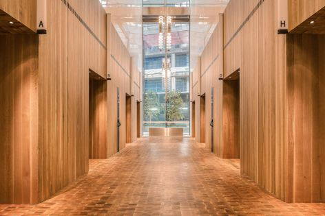 The foyers of the new International Towers Sydney feature quarter-sawn American white oak. Architect: Rogers Stirk Harbour and Partners.
