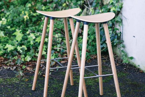 Coma Wood stool by Enea is suited to a wide range of spaces.