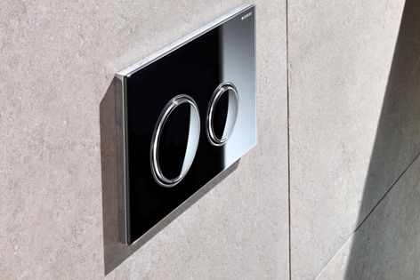 Geberit's Sigma21 flush button plates are available in five finishes: black, white, sand, matt black and slate.