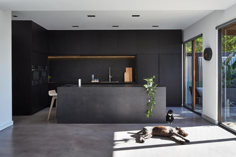 Maximum large-format porcelain panels in 'Moon' are featured in this kitchen by DKO Architecture. Photography: Peter Bennetts.