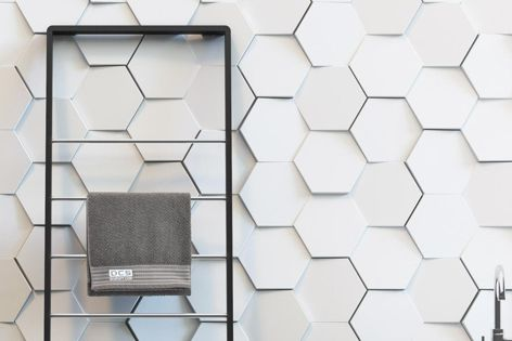 Porton hinged towel rail by DC Short is available in matt black and matt white.