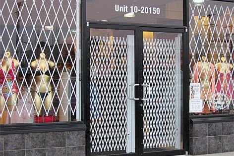 The Double Diamond security trellis door is available in a white or black powdercoated finish.