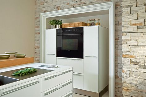 Black Glass E-series oven and matching warming drawer.