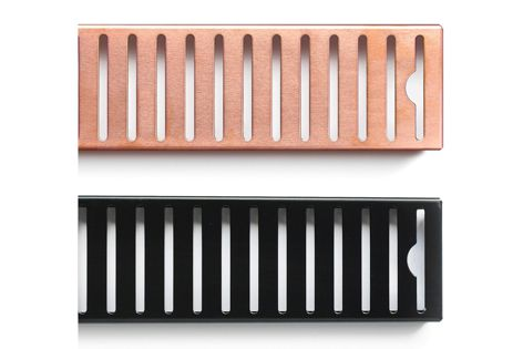 Veitch's stainless steel shower grates in black and copper.