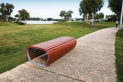Available in a range of sizes and materials, the Environ bench features rounded forms that reference the landscape.