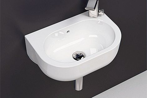 The Pass 45-cm basin is available in colours such as white, light blue, pink and grey.