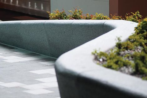 A granite bench from Sai Stone with a flamed finish.