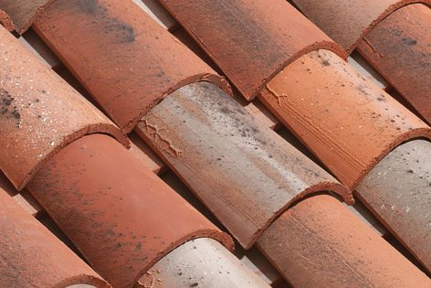 The textured surface gives Cauzac's rustic half-round terracotta roof tiles a hand-finished look.
