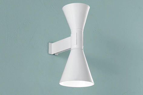 The Appliqué de Marseille lamp showcases monochromatic schemes and dramatic forms.