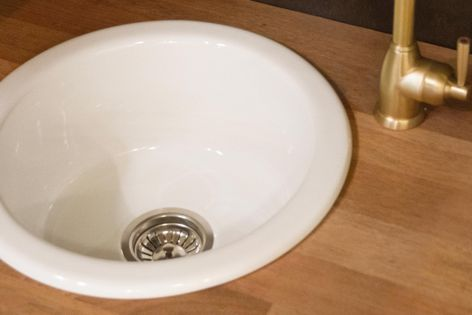 The Acquello Round Sink, ideal for hospitality projects, has deep straight sides and a lustrous white glaze.