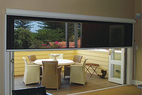 The retractable Issey Flyloc screen blocks heat, glare, wind and rain.