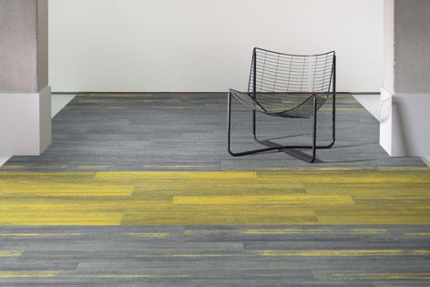Ontera's Colour Compositions carpet plank collection has an aesthetically pleasing, striated design.