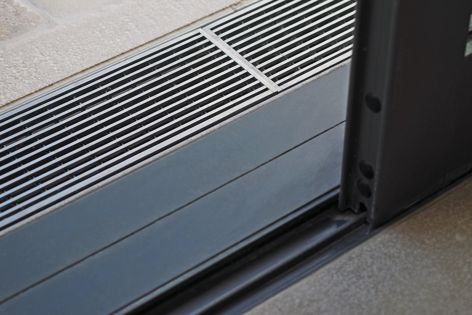 Stormtech's threshold drains integrate elegantly with sliding door tracks, bifolds and hinged doors.