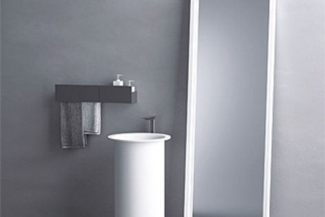 Resembling a magician's top hat, the In-Out washbasin is surrounded by a narrow brim.