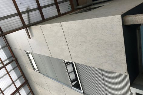 Established in 2010, Barestone prefinished fibre cement sheets have an original, raw look that blends into streets and landscapes.