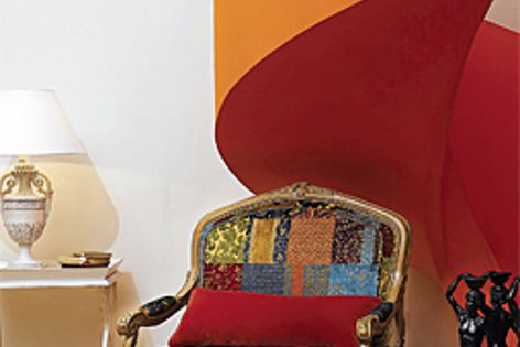 The Louis XV wooden carved armchair with jute upholstery and nails bordering, in a patchwork design.